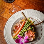 Rack of Colorado Lamb coated in Dijon, rosemary, garlic, and parsley then rolled in fresh panko in a roasted demi-glace accompanied a side of mashed potato and a few stalks of asparagus and carrot (Taken by Erb Photography for Mass Foodies).